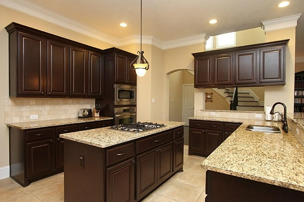 How to install kitchen cabinets for Are kitchen cabinets installed on top of flooring